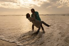 Senior couple dancing together on the beach. Front view of active senior couple dancing together on the beach royalty free stock photo