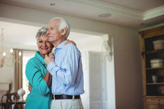 Senior couple dancing together in living room Stock Image
