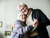 Senior couple dancing together romantic stock images