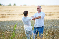 Senior couple dancing in wheat field Stock Photography