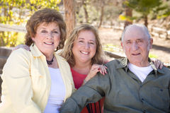 Senior Couple with Daughter in the Park Royalty Free Stock Images