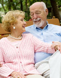 Senior Couple Deeply in Love. Attractive senior couple deeply in love, relaxing outdoors Stock Images