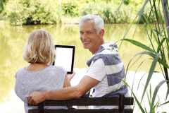 Senior couple with digital tablet Stock Images
