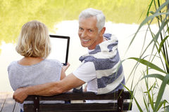 Senior couple with digital tablet Stock Image