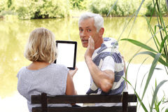 Senior couple with digital tablet Royalty Free Stock Image