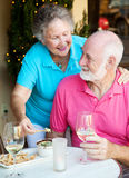 Senior Couple Dining Out. Good looking senior couple enjoying an appetizer and wine at a restaurant Royalty Free Stock Image