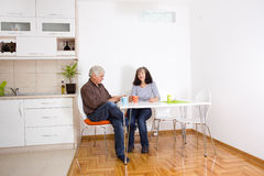 Senior couple in dining room Royalty Free Stock Images