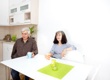 Senior couple in dining room Stock Image