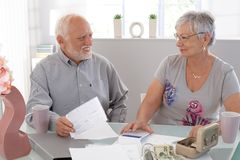 Senior couple discussing finances at home Royalty Free Stock Image