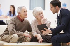 Senior Couple Discussing Test Results With Doctor Stock Image