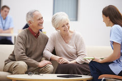 Senior Couple Discussing Test Results With Nurse Royalty Free Stock Image
