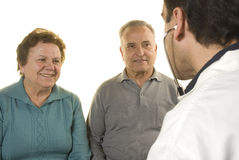 Senior couple at doctor's consultation. On white background Stock Images