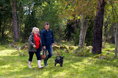 Senior couple with dog. Senior couple going out to pick some mushrooms with their dog Stock Photo