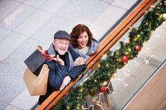 Senior couple doing Christmas shopping. Stock Image