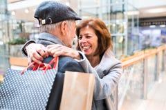 Senior couple doing Christmas shopping. Royalty Free Stock Image