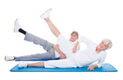 Senior couple doing exercise Stock Photo