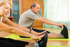 Senior couple doing exercises indoor Royalty Free Stock Image