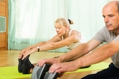 Senior couple doing exercises indoor royalty free stock images