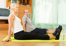 Senior couple doing exercises indoor Royalty Free Stock Photography