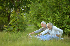 Senior couple doing exercises Stock Photos