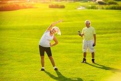 Senior couple doing exercises. Stock Photography