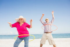 Senior couple doing hula hoop Royalty Free Stock Images