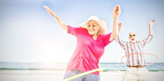 Senior couple doing hula hoop Stock Photo