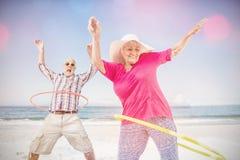 Senior couple doing hula hoop Royalty Free Stock Photos