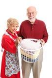 Senior Couple Doing Laundry Together Royalty Free Stock Image