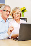 Senior couple doing online shopping with laptop Stock Image