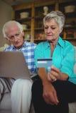 Senior couple doing online shopping on laptop Royalty Free Stock Photo