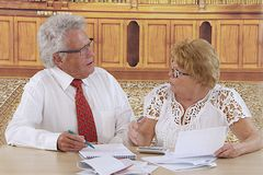 Senior couple doing paperwork Stock Images