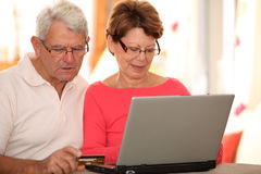 Senior couple doing payment on internet Stock Photos