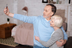 Senior couple doing selfie at home royalty free stock photography