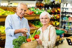 Senior couple doing some shopping together Stock Photos