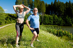Senior couple doing sport exercising outdoors Stock Image