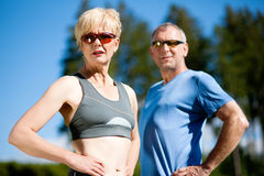 Senior couple doing sport exercising outdoors Stock Images