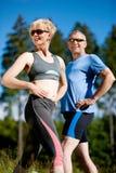 Senior couple doing sport exercising outdoors Stock Photo