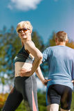 Senior couple doing sport outdoors Royalty Free Stock Photos