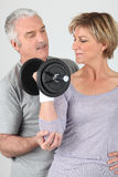 Senior couple doing sports indoors Royalty Free Stock Images