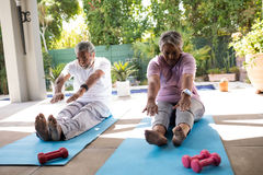 Senior couple doing stretching exercise Stock Photography