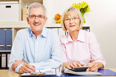 Senior couple doing taxes together Royalty Free Stock Images