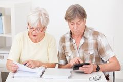 Senior couple doing their finances Royalty Free Stock Photography