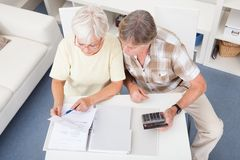 Senior couple doing their finances Royalty Free Stock Image