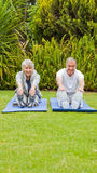 Senior couple doing their streches Stock Photography