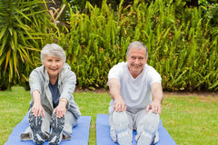Senior couple doing their streches Royalty Free Stock Images
