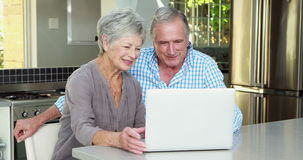 Senior couple doing video chat. In kitchen stock video footage