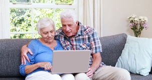 Senior couple doing video chat. On laptop stock video footage