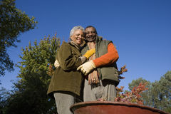 Senior couple doing yard work in autumn Royalty Free Stock Photos