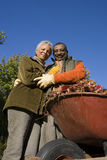 Senior couple doing yard work in autumn Royalty Free Stock Photography